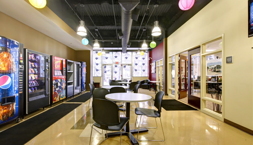 Break room with tables and vending machines inside Oak Brook facility