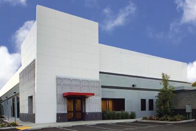 Exterior view of a white data center building in Santa Clara California.