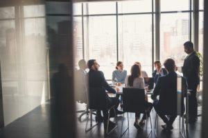 Company meeting inside a boardroom