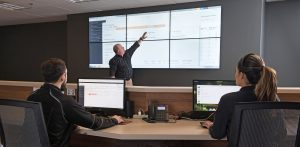 CH1-NOC-Workers remotely managing data centers in the Network Operations Center