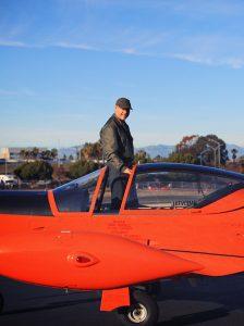 Avner standing inside of Marcetti airplane